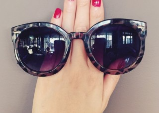 rain nails and oversized sunglasses